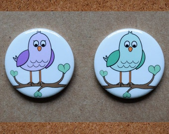 """Cute bird boy and girl gender reveal pins.  purple and green.  1.25"""" or 2.25""""."""