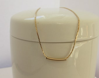 Rose gold chain with a floating 14k Gold Noodle Tube necklace and matching bracelet