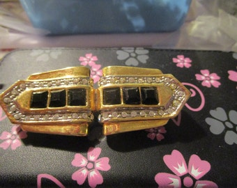 "vintage goldtone heavy brooch with square dark stones/diamantes 2.75"" across x 1.25""good condition"