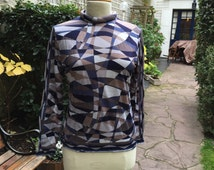 SALE-Vintage authentic, Emilio Pucci, Firenze, fine pure wool roll neck blouse. Size 42 in different shades of blue and grey.
