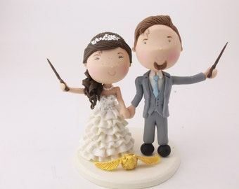 Magical couple with golden snitch. Harry Potter Theme. Wedding cake topper. Wedding figurine.  Handmade. Fully customizable. Unique keepsake