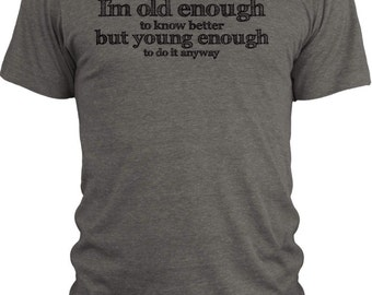 Big TexasI Am Old Enough to Know Better (Black)  Vintage Tri-Blend T-Shirt
