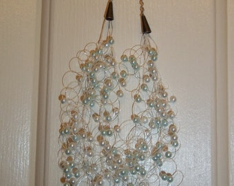 light blue and white pearl air necklace