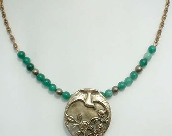 Art-deco bronze necklace  :  Medalliondecorated with a  bird flying over flowers,emerald and pyrit beads, vintage Kette 022I-022