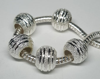 One Silver Stardust Spacer Bead for European Bracelets (item S011)