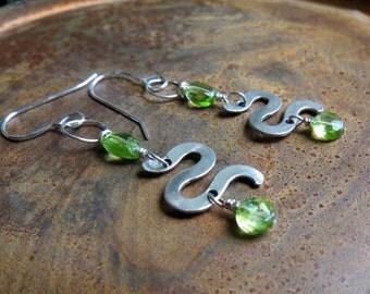 gemstone peridot earrings. SEXY SNAKES. sterling silver earrings. green earrings. snake earrings. August birthstone earrings. Leo earrings.