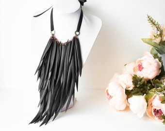 Long feathers necklace with recycled inner tube and copper. Eco-friendly jewelry.