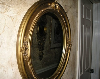 Vintage Chic French Gilt Wood Ornate Carved High relief Framed Wall Mirror/Parlour Mirror Glam.