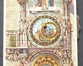 Intriguing 'clock' postcard with movable 'wheel' on the side which changes the figures in the window.  (Prague Astronomical clock.)