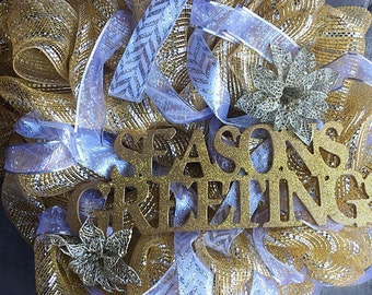 "Gold and silver ""Seasons Greetings"" wreath"