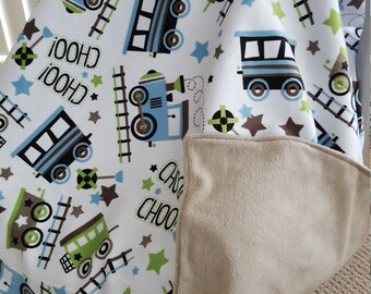 Baby car seat cover/blanket.  Trains, blue and green.