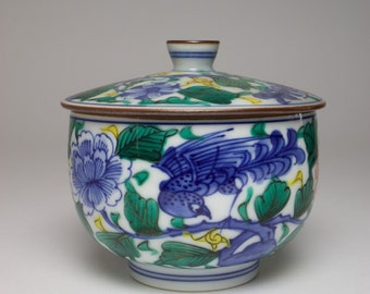 Vintage Oriental porcelain hand painted birds and flowers pot and cover.