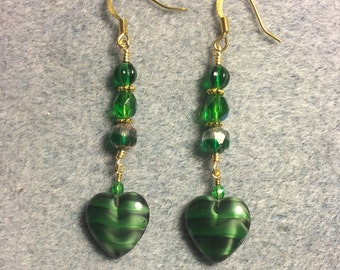 Opaque emerald green Czech glass heart bead dangle earrings adorned with emerald green Czech glass beads.