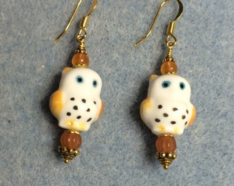 Orange and white ceramic owl bead dangle earrings adorned with orange Czech glass beads.