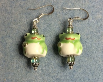 Green ceramic frog bead dangle earrings adorned with green Czech glass beads.