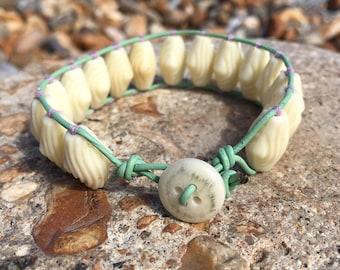 Vintage Cream unusual contoured bead wrap bracelet - On Mint Green leather