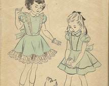 1940s Vintage Advance Sewing Pattern 5067 Girl's Puffed Sleeve Tie Back Dress Peter Pan Collar Size 2