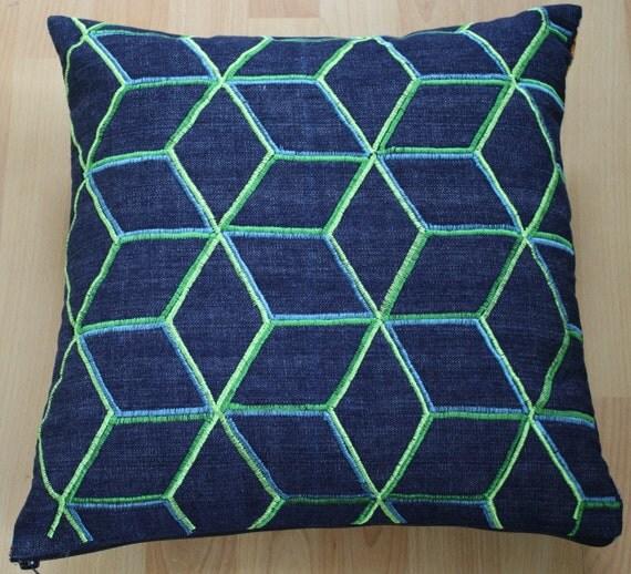 Geometric machine embroidered cushion