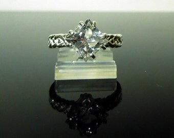 Unusual Herkimer Diamond Engagement Ring - This size 8 braided sterling silver setting holds a 2.5 ct. princess clear cut crystal gemstone.