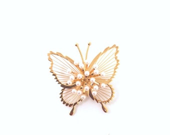 Monet gold tone  butterfly brooch with faux pearl encrusted wings. Signed jewelry