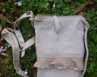A pretty linen bag with adjustable strap for over the shoulder or across the body.
