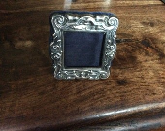 A Solid Silver Exquisite Repousse Picture Frame
