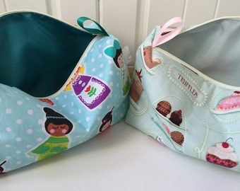 Beautiful cosmetic bag in cotton print with water resistant lining.