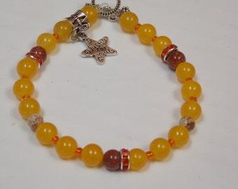 Beaded hand made,bracelet w/ silver star