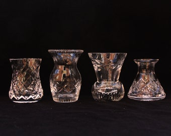 Four small vintage crystal vases