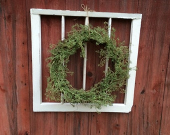 Vintage window frame from an old Bungolow home. Has a ton of character, wreath is not included, but shown to give you a decorating idea.
