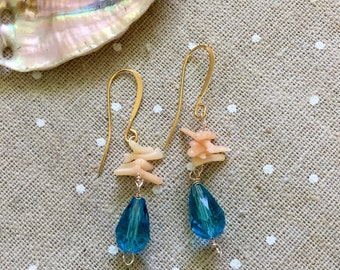 Peach coral pieces and teardrop aqua glass bead on gold tone hooks