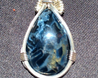 Blue pietersite, with beautiful flecks within,  neatly wire wrapped in fine silver.
