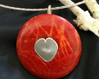 Red coral donut with sterling silver heart baille.