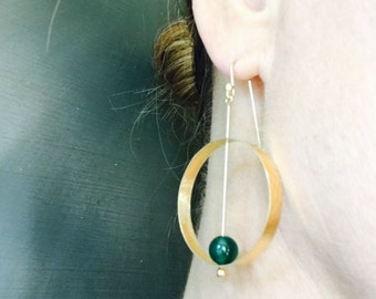 Dangle hoop earring. Hand forged in sterling silver with 24KYG plating and green onyx bead.