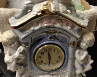 Ceramic Clock with Cherubs on Each Side