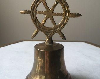 "Vintage Brass Nautical Wheel Bell 6 3/4"" Tall."