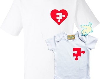 Father and baby T-shirt and baby grow set with heart on fathers t-shirt and part from heart as puzzle piece on baby's grow.
