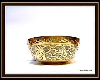 Vintage brass bowl made of engraved copper.
