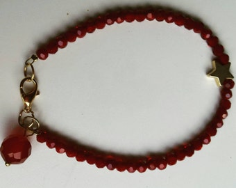 Beautiful bracelet of faceted beads and star of Golden lock