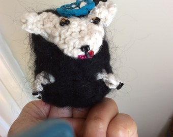 Crocheted and felted lamb puppet and pin