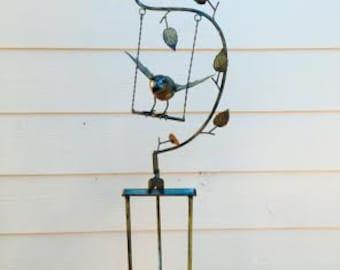 Wind Driven Garden Art Bird on a Swing