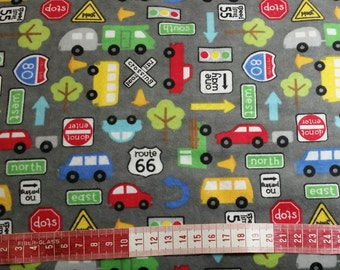 Grey street scene with sign and cars. Brushed cotton flannel