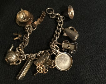 Vtg Mid Century Vintage CHARM BRACELET 9 charms SilverTone metal Moving parts Wagons,Wheeled Carts,Harmonica,Turning chair cup saucer plus