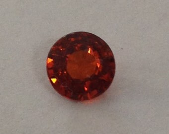 1.70 ct fancy round 6.8 x4.1 mm Firey neon like red orange color
