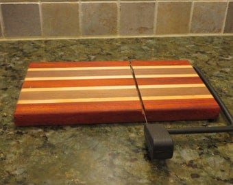 Cheese slicer, cheese cutter with wood serving board