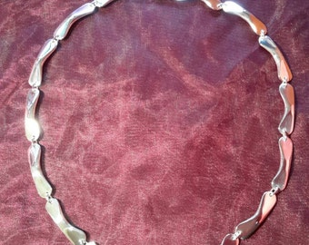 Hand forged sterling silver Bomerang link necklace