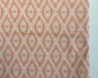 Peach and blush kilim design fitted crib sheet