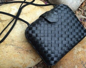 Vintage La Regale black woven clutch