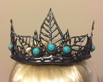 Steel colored crown with blue and silver jems