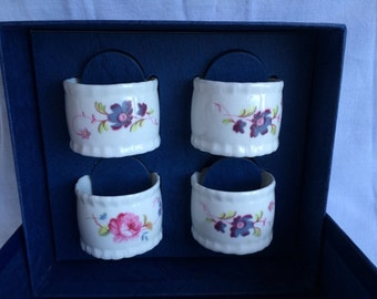 Coalport Napkin Porcelain Rings in a box. Floral motive. Made in England.